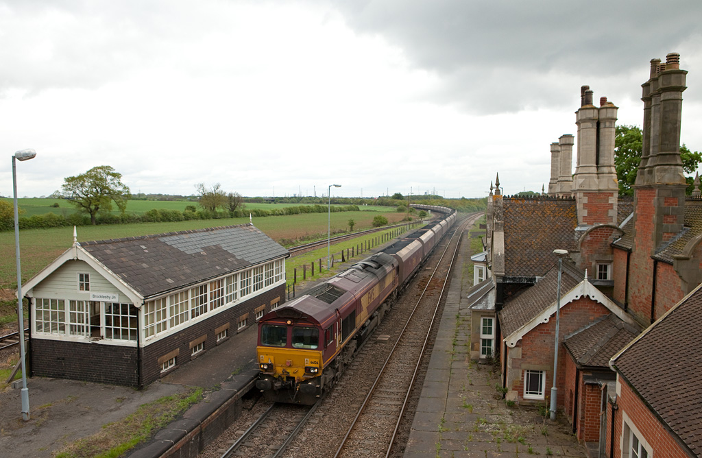 EWS 66126 with a loaded coal train passes through Brocklesby Junction.