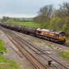 EWS 66142 with the 6E32 08:55 Preston Docks-Lindsey empty bogie tanks in Brocklesby Junction.