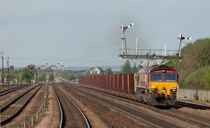 EWS 66063 leads the 6K21 08:06 Santon-Immingham empty iron ore tipplers in Wrawby Junction.
