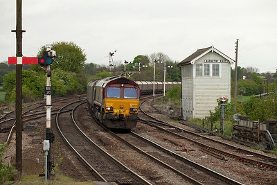 66076 heads the 6C05 08:45 Immingham-Eggborough Powerstation loaded EWS coal hoppers passing Barnetby East.