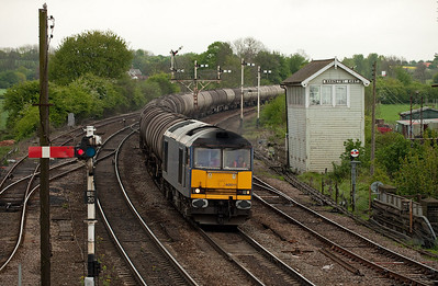 60011 with the 6N04 08:01 Lindsey-Jarrow loaded bogie tanks passes Barnetby East.