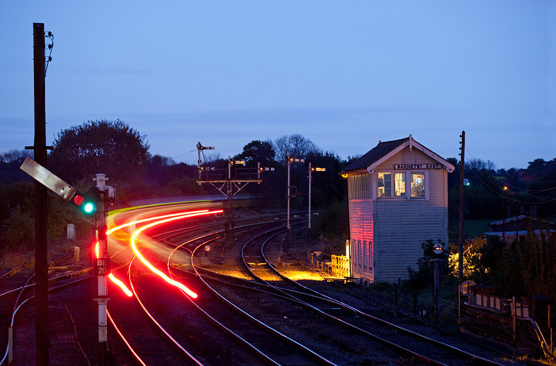 """First Transpennine Express passes Barnetby East signal box during the """"blue hour""""."""