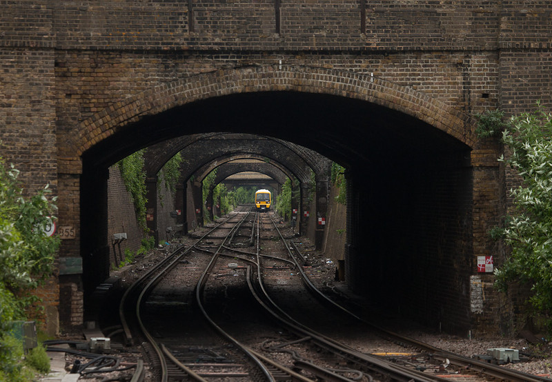 """Southeastern Trains 465 169 in the """"trench"""" approaching Gravesend Central station."""