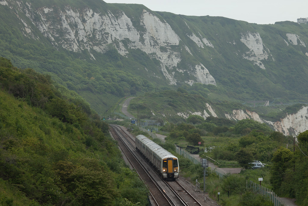 Southeastern Trains 375 813 passes the old Warren Halt between Dover and Folkstone.