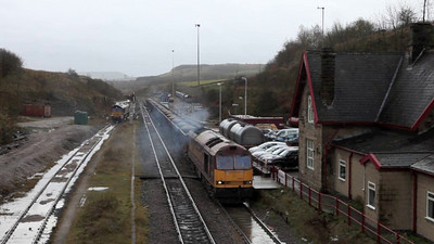 60051 leaving Peak Dale with a loaded stone train.