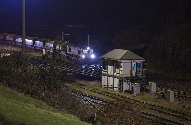 Class 66 pulling loads at night in Peak Forest South.