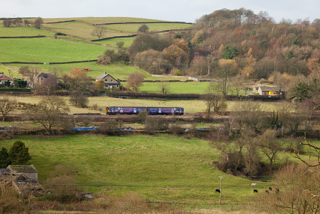 DMU to Buxton approaches Furness Vale station.