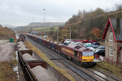 EWS 60051 with a rock train ready to depart Peak Dale. Note flooding caused by heavy rains.