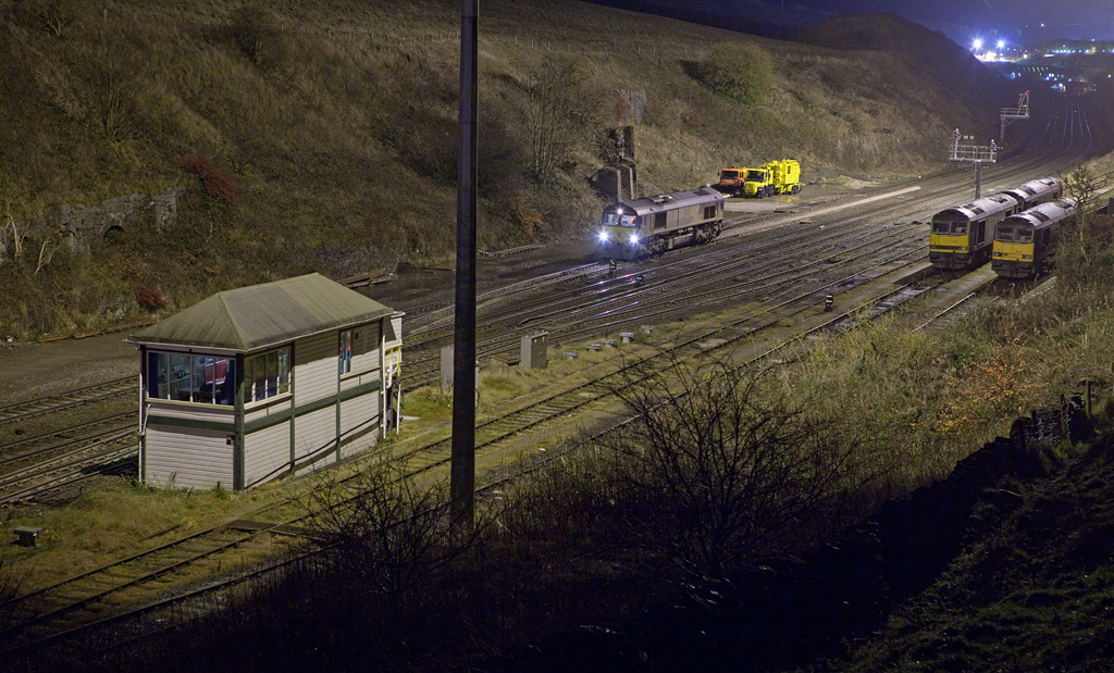 EWS 66011 shunting at night in Peak Forest South.