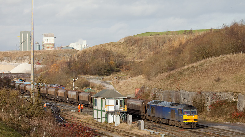 EWS 60011 with a rock train passes Peak Forest South signal box.