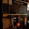 "Menu and stove, <a href=""http://www.thestationinn.net/"">Ribblehead Station Inn</a>."