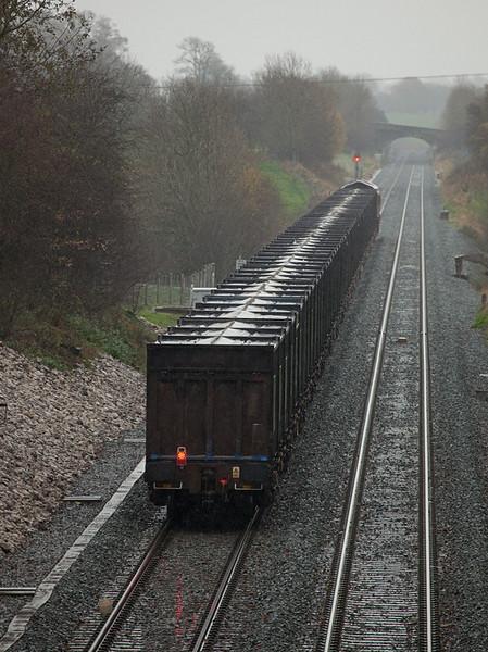 EWS 66015 with empty gypsum train leaving Kirkby Thore.