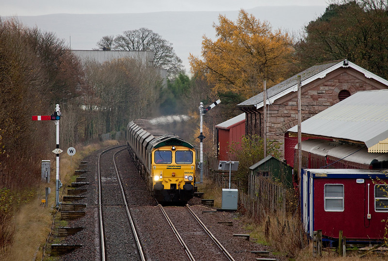 Freightliner 66548 with coal train approaching Appleby station.