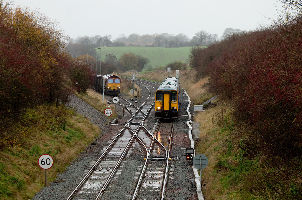 153 315 and EWS 66015 with empty gypsum train in Kirkby Thore.