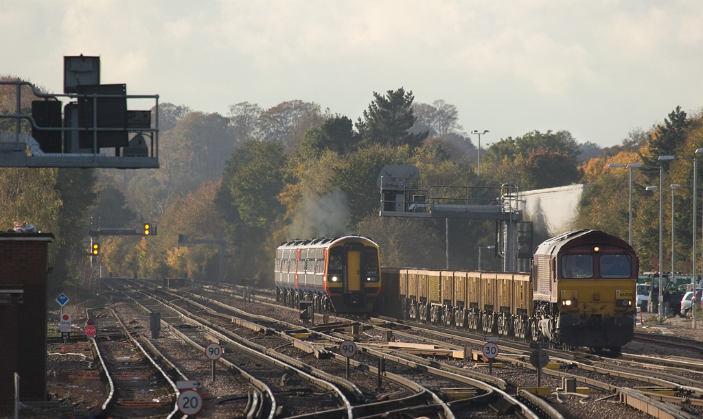 159 107 and EWS 66200 with the 6V27 13:50 Eastleigh Yard - Hinksey VQ departmental approaching Basingstoke.