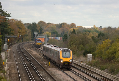 Crosscountry DMU Manchester Picadilly - Portsmouth overtakes EWS 66067 with the 4O04 9:35 Washwood Heath - Eastleigh Yard intermodal in Worting Junction.