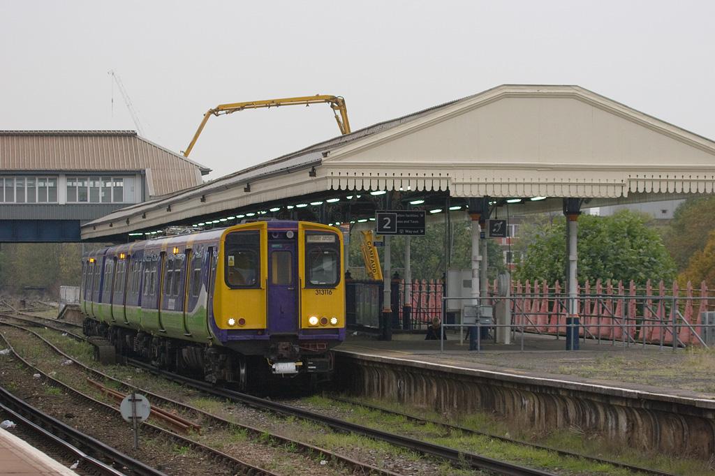 London Overground 313116 in Clapham Junction.