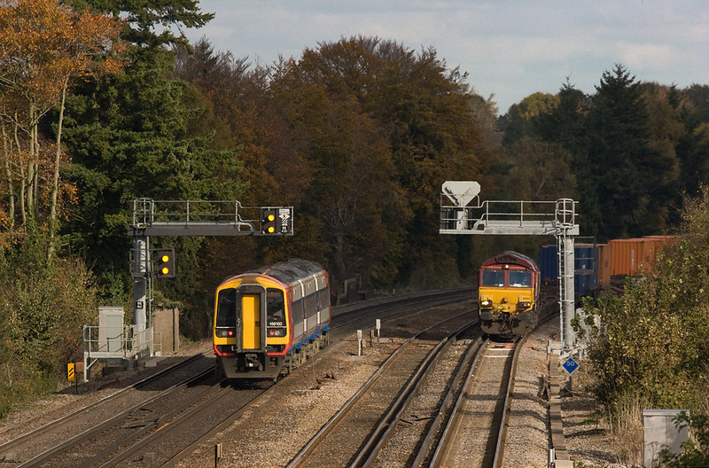 159 103 passes EWS 66067 with the 4O04 9:35 Washwood Heath - Eastleigh Yard intermodal stopped at Worting Junction.