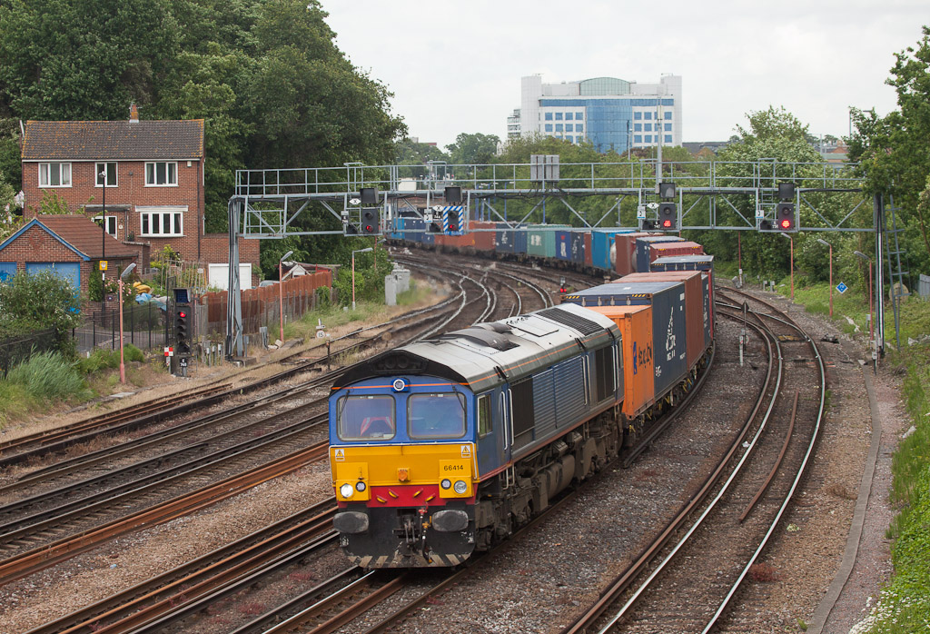 Freightliner 66414 brings the 4O54 (06:15 Leeds - Southampton Maritime Freightliner) through Southampton, Hants.