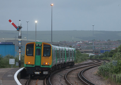 Southern 313 219 between Newhaven Harbour and Newhaven Town, Sussex.