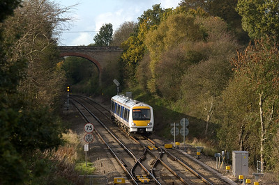 "This view looks north at Hatton North Junction as a London Marylebone-bound DMU comes flying through. The signal on the other track still displays ""advance approach"" from a northbound that passed before.  Chiltern Railways DMU class 168/2 southbound at Hatton North Junction."
