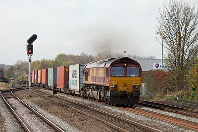 EWS 66122 with a container train in Leamington Spa.