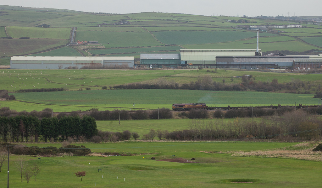 Steel train passes in front of Tata Steel Long Products Europe, Special Shapes Section, Skinningrove.