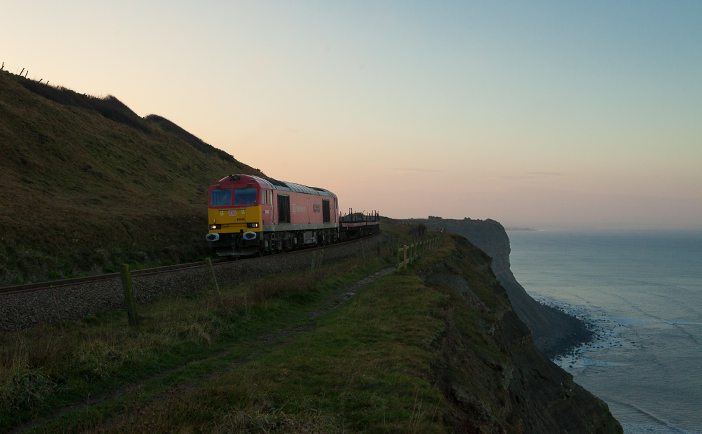 60040 on the steel train 689W to Skinningrove on Cattersty Cliff after sunset.