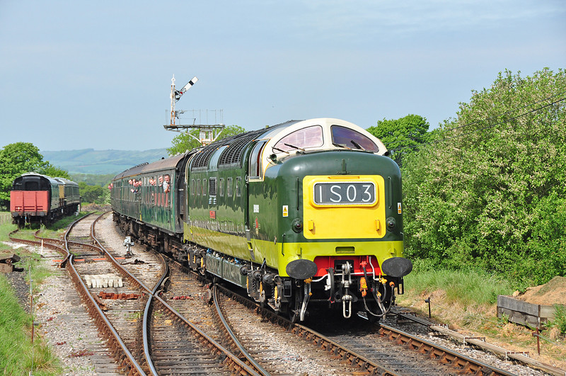 "The classic lines of the Deltic locomotive can be seen as D9009 ""Alycidon"" arrives at Harmans Cross, with just a few people leaning out of the windows taking in the sound made by the former East coast racehorse 05/2011."