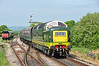 """The classic lines of the Deltic locomotive can be seen as D9009 """"Alycidon"""" arrives at Harmans Cross, with just a few people leaning out of the windows taking in the sound made by the former East coast racehorse 05/2011."""