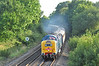 """With the characteristic Deltic sound & a haze of clag, 55022 """"Royal Scots Grey"""" rounds the curve at Silchester with Pathfinders 1Z76 """"The Dorset Deltic Explorer"""". Having been to Weymouth she is seen on the return leg to Crewe in some welcome evening sun 03 September."""