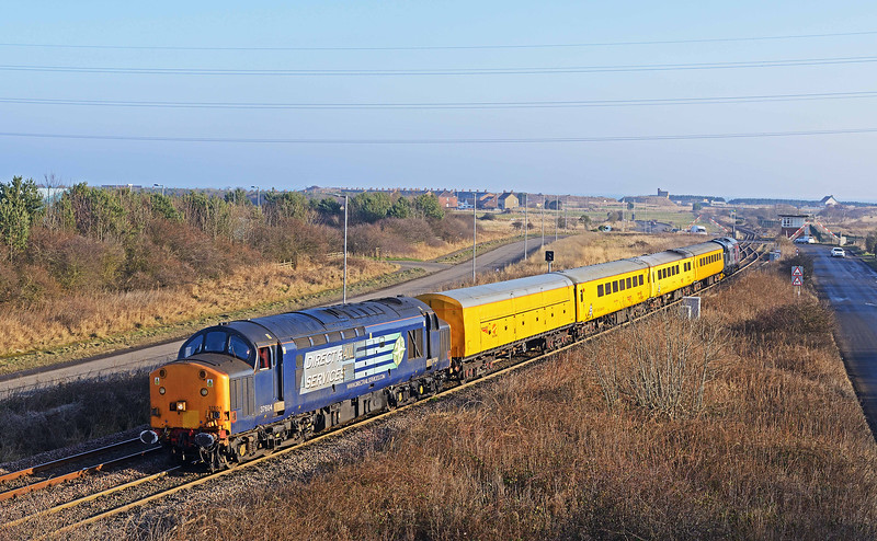 37604 with 37608 on read gets away from Freemans Crossing with a North Blyth to Tees Yard test train on 23rd January 2017. Heaven knows what's going on with the barriers!