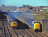 The race is on! 55018 BALLYMOSS working the 05.50 KX to Aberdeen and 40196 on Heaton bound ECS are neck and neck at Shieldfield on 4th October 1980. I was awaiting the Deltic and could hear it coming when I became aware of another cacophony on the slow lines. I could see a shadow under the bridge and was hoping that it would not ruin the shot of the Aberdeen. As it turned out it was not too bad. The crew on the 40 were giving it a go but it was an unequal contest as the Deltic had a short train and the 40 would soon have to slow down to go into the carriage sidings. The whole thing arose as the guard on the 10.12 to Cardiff, for which 40196 was the only loco available, flatly refused to take the train with a non-ETS engine and there was no alternative but to send the whole ensemble back to Heaton. It set off much later with either a 47/4 or 45/1, the latter being the booked power.