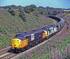 37517 + 37682 running downhill towards Carlisle with coal empties from Blyth PS to Hunterston on 2nd August 1995.