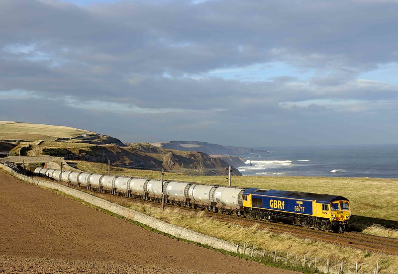 66717 'GOOD OLD BOY' is seen against a stormy North Sea backdrop skimming along the Berwickshire clifftops working Aberdeen to Parkeston mud oil tanks on 9th November 2007.