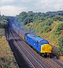 37037 looks luminous in its ex-works BR blue livery as it races south through the cutting at Sunderland Bridge on the return leg of a successful Doncaster Works trial. This makes an interesting comparison with my picture of it working the WH sleepers 3 years later.
