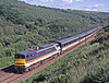 It's unusual to get a 91 going north blunt end first. However here is 91022 racing down past Penmanshiel with a KX to Edinburgh on 4th July 1993. It's short-formed too. Only 8 coaches.