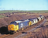 37s on the potash! 37330 + 37358 roll down from Huntcliff towards Skelton with another load of potash from Boulby mine for export through Teesport on 15th February 1995.
