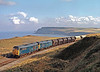 31141+31130 are reaching the top of the climb from Crag Hall to Hunt Cliff with a train of potash from Boulby Tees yard to which 5 empty oil tanks have been added at Skinningrove on 5th October 1977 – 39 years ago! This was a difficult location as it was not possible to see approaching trains and there was so much noise from the works at Skinningrove that it was not always possible to hear them. It must have taken ages to attach the oil tanks and the sun was dropping like a stone. They came in the nick of time – see shadow.