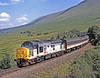 37424 is entrusted with the WTHO morning Fort William to Polmadie ECS train formed of the previous night's West Highlander from Euston to be serviced. It will cross the northbound train about Arrochar. Seen here on 3rd August 1995, an idyllic Summer's day, rolling down past Achallader  Earlier this loco had worked north on the loaded sleeper train.