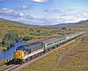 37402 OOR WULLIE begins the descent of Glen Carron with a Sunday Inverness to Kyle of Lochalsh working on 5th September 1993.