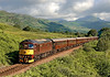 A rare event. I  normally try to avoid WCRC trains in view of my poor opinion of the management but when I found that 33029 was to work the Royal Scotsman south from Bridge of Orchy on 7th July 2007 I decided to make an exception. On a typically overcast West Highland morning I was lucky that the train co-incided with a brief sunny spell as a result of which it is seen against the incomparable light and shade of the Loch Lomond area. Leaving Ardlui at about 09.00.