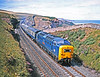 In the days when Deltics were still the front line power, 55011 was a surprise rushing along the Berwickshire clifftops at Marshall with a scratch relief on 31st July 1977. Pretty clean for a Gateshead engine!