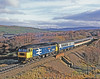 At the end of its long journey from Euston via Birmingham and Edinburgh the CLANSMAN is on the last lap as a tired looking 47636 struggles up the last few hundred yards to Slochd summit on 11th April 1990. Downhill all the way now!