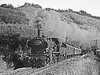 This is a German equivalent of our Black 5. The train is the 17.xx Trier to Junkerath running along the southern end of the Eifelbahn – a secondary route from Trier to Cologne which did not follow the Mosel and Rhein valleys but meandered through the hills to the west. A lovely route which was all steam in 1966. There were some expresses worked by Pacifics and the freight had Cl 44 3cyl 2-10-0s.