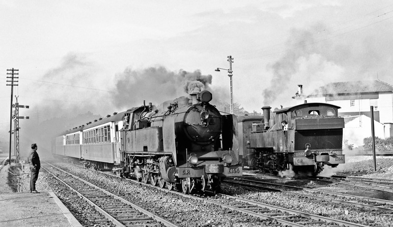 E144, an impressive modern(1930s) 2-8-2T is running into Senhora da Hora with an outer suburban train from Povoa de Varzim, 24km to the north. E164 waits to immediately follow it to Porto Trindade calling at the 4 intermediate stations. E144 will go fast(?) to Porto. I am so glad that I am old enough to have seen this unbelievable operation while it was still all steam. The 10 0-4-40Ts were built by Henschel in 1908, so were 68 years old in these pictures – dignified old ladies!