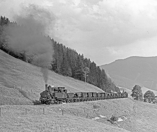 A pair of 97s on the legendary rack worked line from Hieflau to Eisenerz. The train is formed of empty iron ore hoppers.