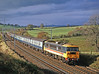86417 THE KINGSMAN passing Docker with the morning Euston to Carlisle semi-fast on 28th October 1987. Lucky with the sun.