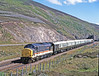 """""""Mary"""" is shepherding her Royal Scotsman coaches into the loop at Slochd Summit to allow an Inverness to Edinburgh service to pass on 23rd July 1990. This combination of vintage power and rolling stock had much more character than today's all maroon offering but at least we are now spared the monotony of one of WCRC's  miserable locos."""