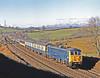 86241 GLEN FIDDICH, still in corporate blue hurries north past Docker on a Birmingham to Glasgow on 23rd February 1988,